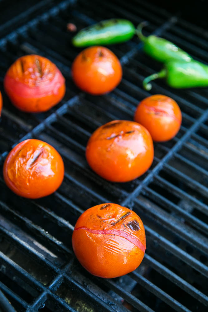 Grilled tomatoes and jalapenos for homemade Smoky Grilled Salsa | Perrysplate.com #salsarecipe