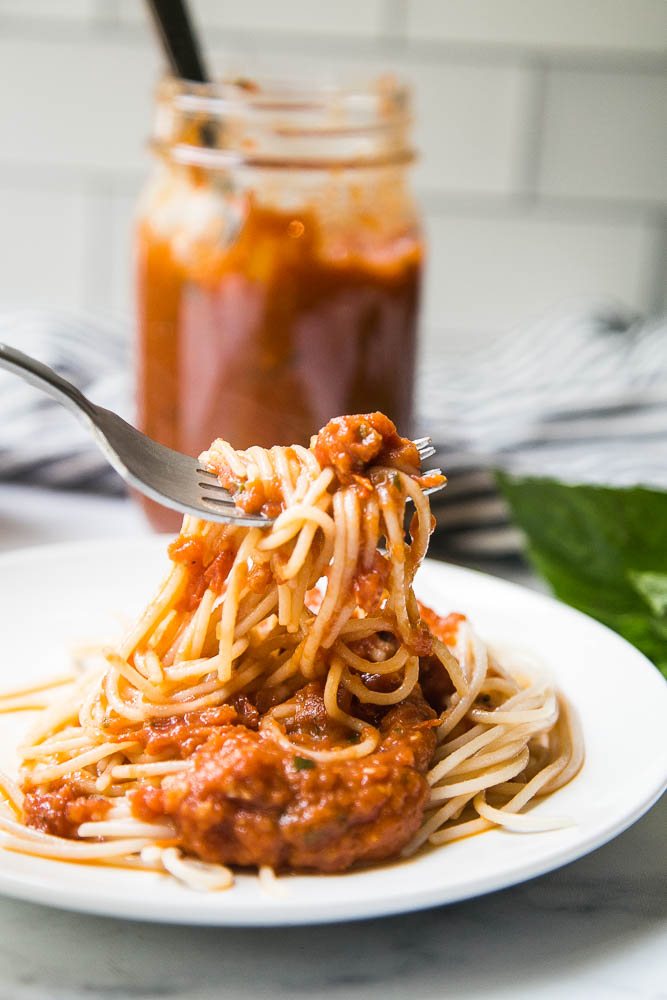 This easy Balsamic Roasted Tomato Sauce is totally delicious and versatile! Use it in any recipe that calls for marinara or on pizza.   perrysplate.com #tomatorecipes #tomatosauce