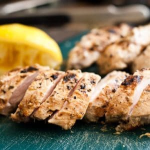 This Perfect Grilled Lemon Chicken is super easy to throw together and VERSATILE! Make extras during meal prep and add it to salads, wraps, and skillet dinners during the week! | Perrysplate.com