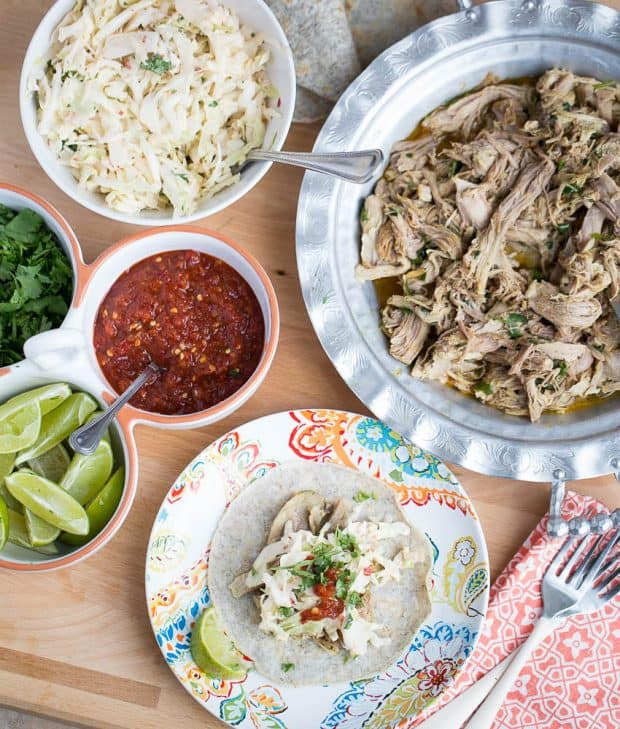 Thai Pulled Pork Tacos with Creamy Chili Slaw -- one of my favorite recipes that use Thai seasoning! From The Big Book of Paleo Slow Cooking by Natalie Perry