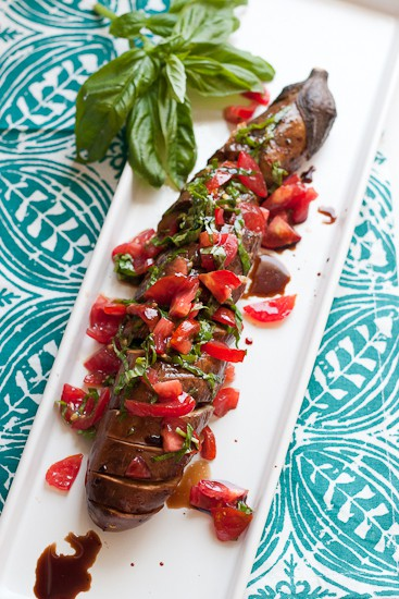 This is such a fun grilled vegetarian grilled dish! Garlic-studded eggplant turns silky soft when grilled for a long time and that slightly spicy tomato relish is the perfect topping! | perrysplate.com
