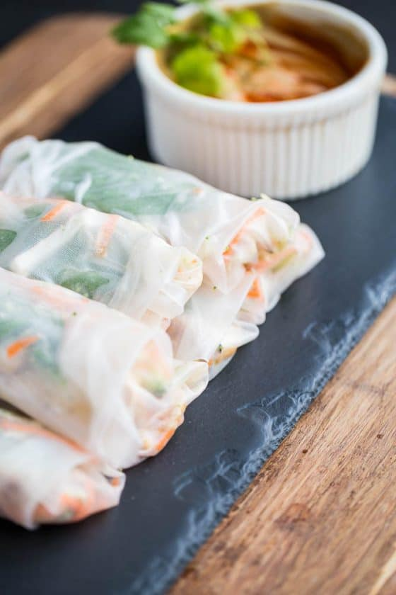 """Thai Chicken Spring Rolls with Spicy """"Peanut"""" Sauce -- A gluten-free and paleo-ish dinner that's great for a warm summer night. The Thai grilled chicken and nutty sauce are a winning combination! 
