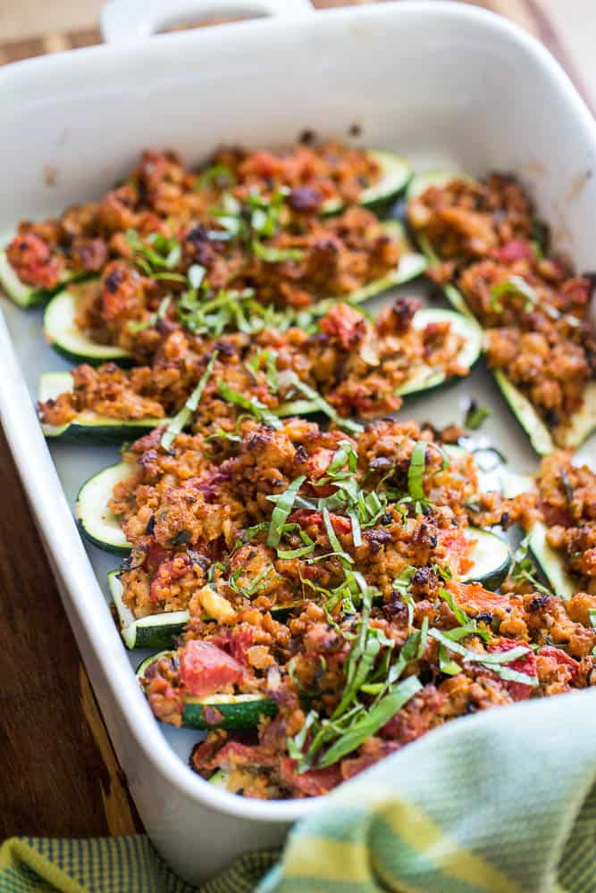 "Here's a great use for all of that zucchini spilling out of your garden at the end of the summer! I love the addition of fresh herbs and the ""cheesy"" taste the nutritional yeast adds! You'll love this paleo and Whole30 friendly meal."