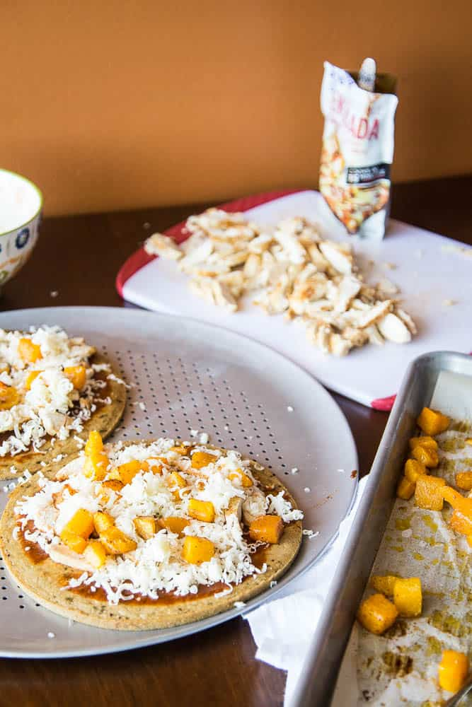 Mexican Chicken Pizza with Butternut Squash -- Using pre-made paleo pizza crusts (or any pizza crusts) makes this an even faster meal to prep! I love the sweet roasted squash combined with the Mexican flavors of the enchilada sauce.   PerrysPlate.com