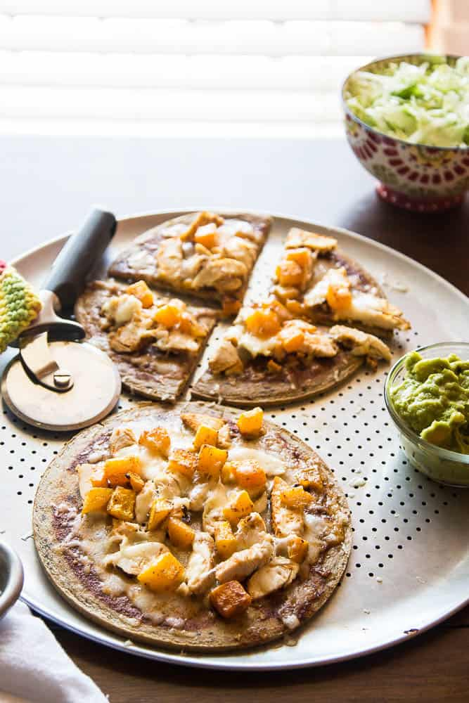 Mexican Chicken Pizza with Butternut Squash -- Using pre-made paleo pizza crusts (or any pizza crusts) makes this an even faster meal to prep! I love the sweet roasted squash combined with the Mexican flavors of the enchilada sauce. | PerrysPlate.com