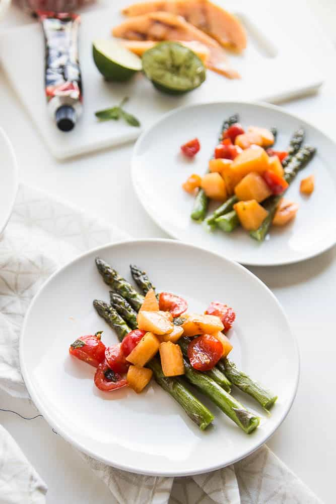 Have you ever grilled melon? It intensifies and caramelizes the natural sugars and adds a little smokiness. It's divine. This gluten-free and dairy-free Asparagus and Grilled Melon Salad is from Giada's Italy by Giada De Laurentiis. Grab the recipe and read a review of her book! | perrysplate.com