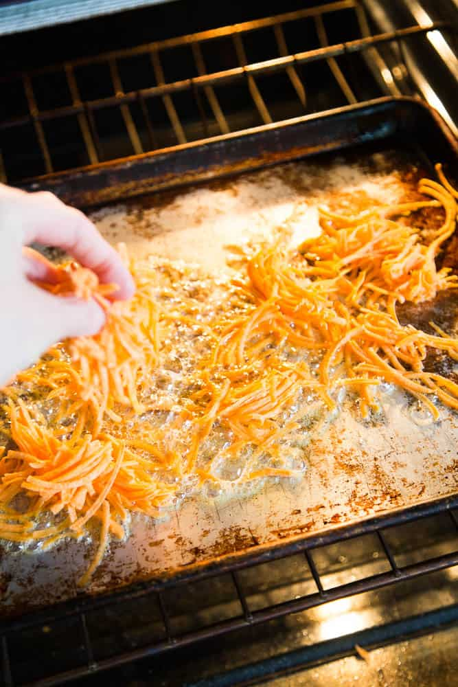The secret of making crispy sweet potato hash browns is roasting them on a hot pan with plenty of bacon drippings or ghee. Step by step tutorial over at perrysplate.com! | sweet potato recipes | paleo recipes | Whole30 recipes