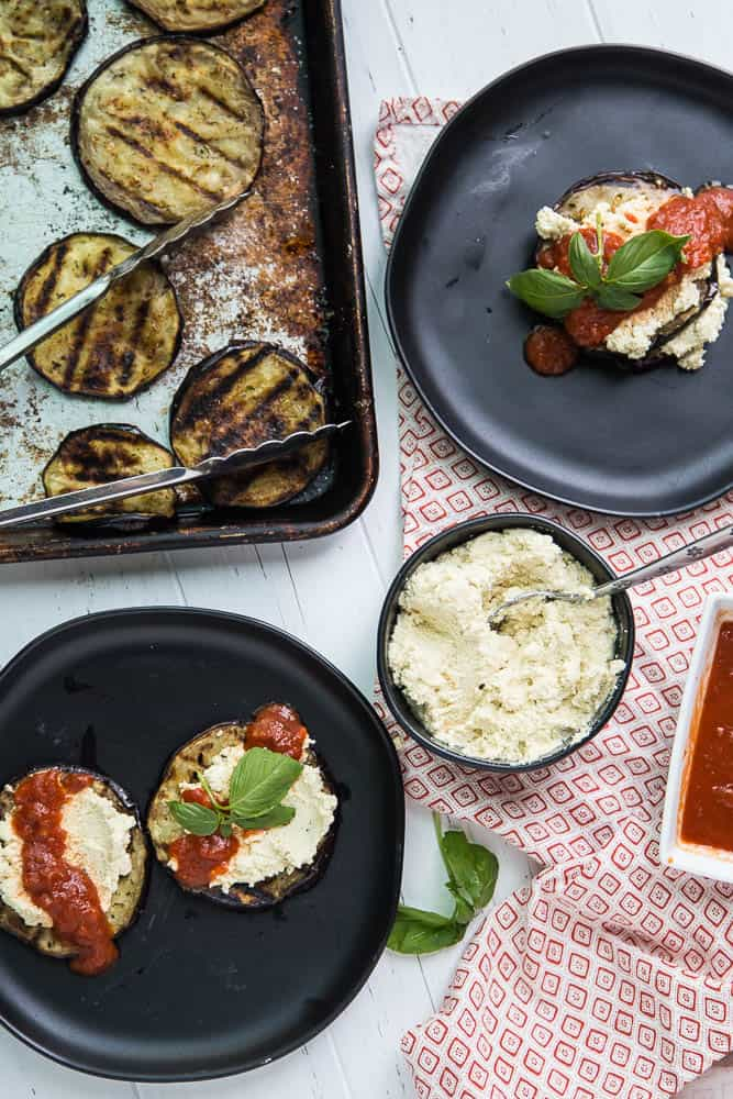 "Have you ever tried macadamia ricotta ""cheese""? It's hearty, dairy-free alternative to ricotta filled with lots of healthy fats. These Grilled Eggplant Stacks remind me of lasagna, but much less fussy. It's also low-carb and Keto friendly! 