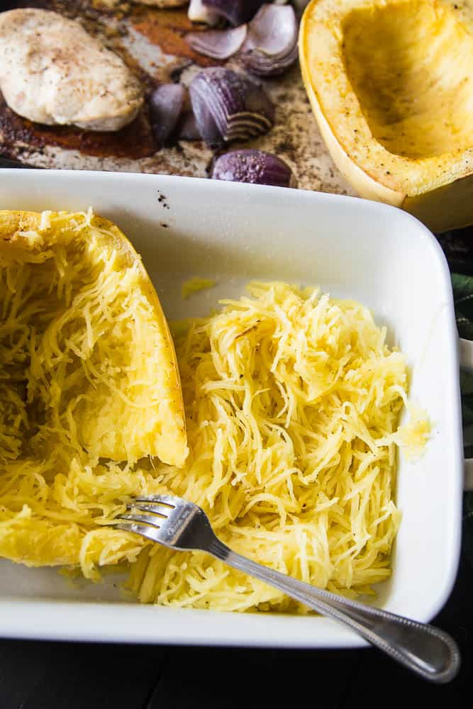 Green Chile Chicken & Spaghetti Squash Bake | This keto/Whole30 friendly spaghetti squash bake is PERFECT for meal preppers or those who like to prep components of a meal ahead of time. I love the addition of green salsa and a splash of paleo ranch to give it some creaminess. Avocados on top are a must! | PerrysPlate.com