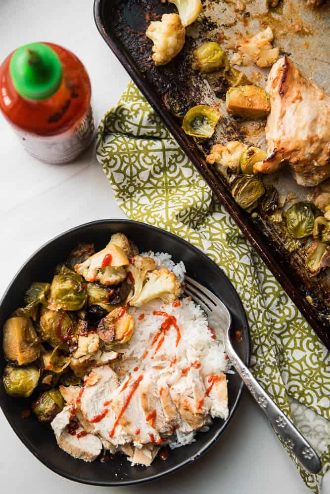 A sheet pan dinner is your best friend -- especially on the weeknights. This sheet pan BFF has chicken & veggies that cook up in a super easy Thai-inspired marinade. You can serve it as is (Paleo/Keto/Whole30 friendly!) or with some freshly steamed Jasmine rice. | PerrysPlate.com