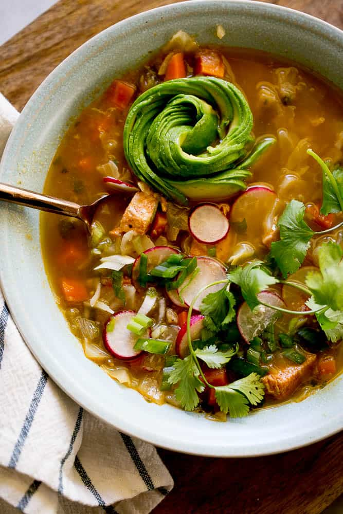 This Instant Pot Chicken Tomatillo Soup is perfect all year round! It's a perfect #paleo, #keto, or #Whole30recipe. Just don't skimp on the avocados! | perrysplate.com