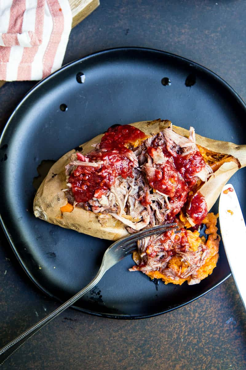 BBQ Pulled Pork is SO easy in an Instant Pot pressure cooker! You can turn a big pork roast into tender shreds of sweet BBQ in under 2 hours! | perrysplate.com #instantpot #bbqpulledpork