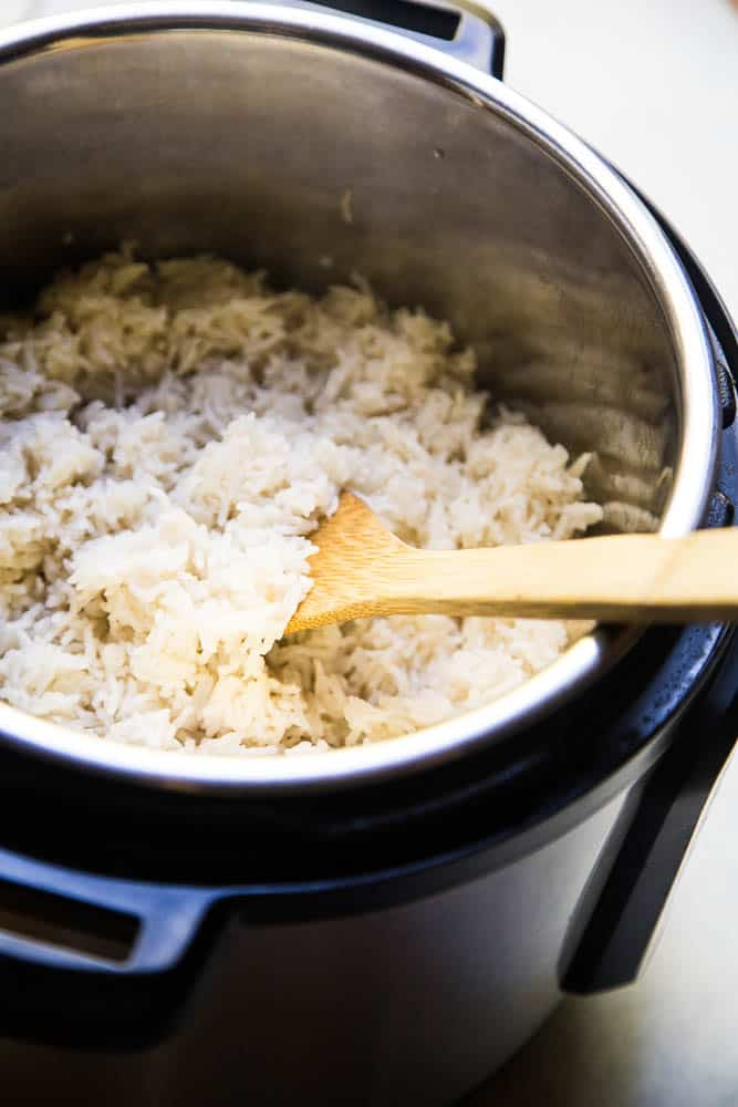 Instant Pot Coconut Rice is the ONLY thing I make with curry these days! It's super easy and only a few ingredients! | PerrysPlate.com #instantpotrecipes #coconutrice