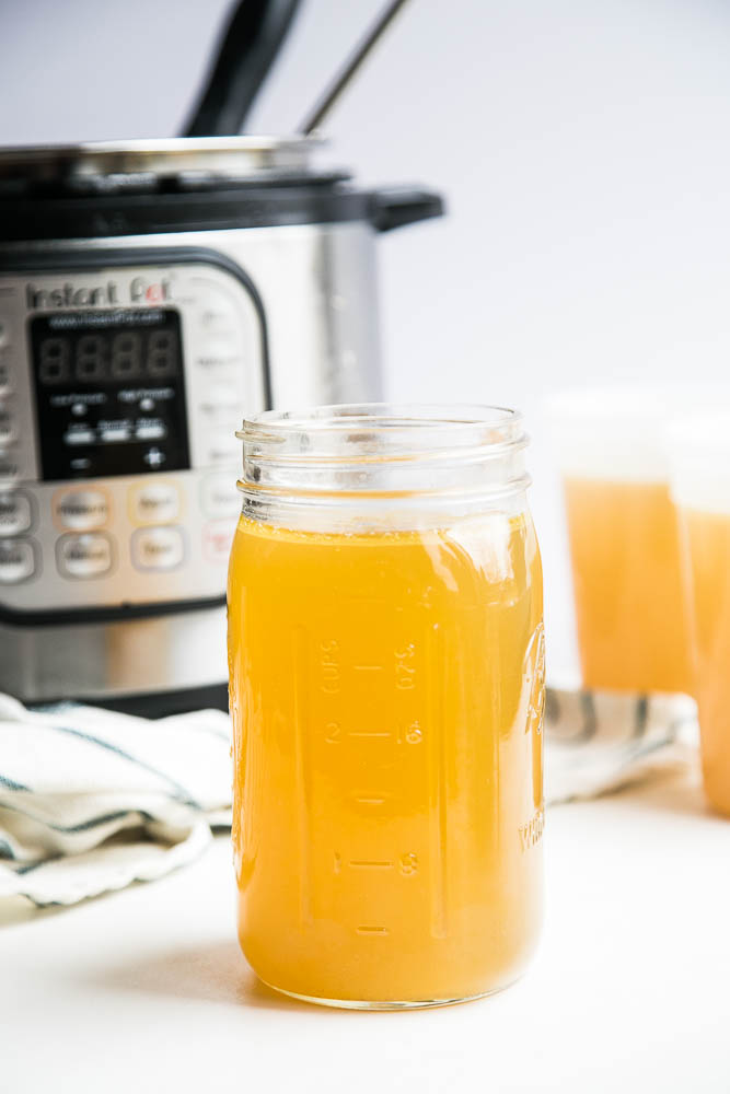 Make homemade chicken bone broth in under 3 hours with your Instant Pot! No more simmering a pot on the stove for an entire day. | perrysplate.com #instantpot #instantpotrecipes #bonebroth