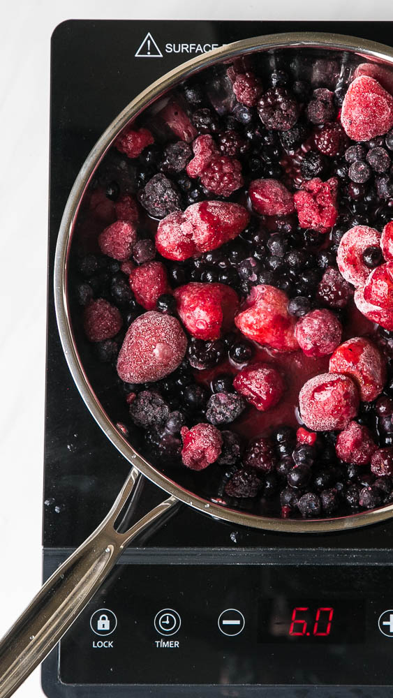 Keep a bag of frozen berries on hand to make this quick 3-ingredient sauce! Use it on crepes, waffles, pancakes, ice cream or over custard! | perrysplate.com #paleodessert #frozenberries #ketodessert