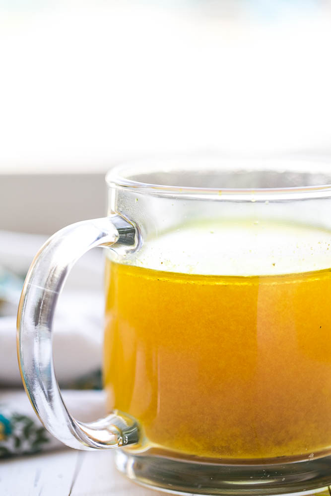 This flavorful bone broth has a handful of immunity-boosting ingredients and is perfect for sipping when you're sick. | perrysplate.com #bonebroth