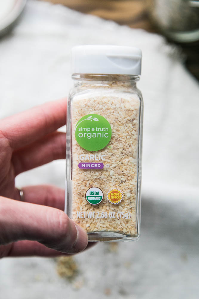 You can find dried minced garlic in the the bulk spice area of grocery stores that offer it. Or sometimes you can find it in the regular spice section.