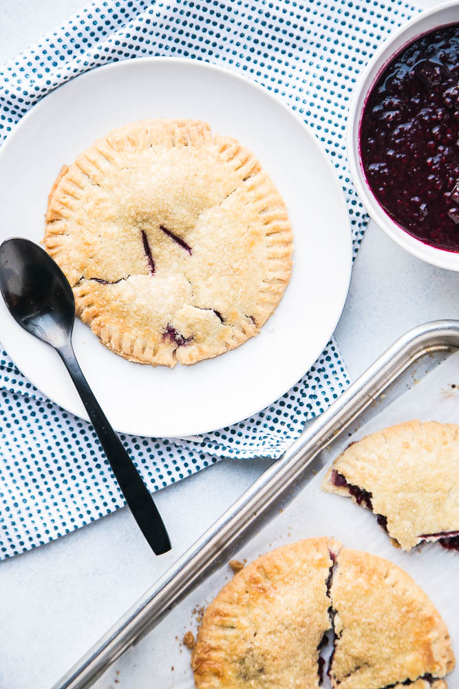 Gluten-Free Berry Hand Pies are made with the best gluten-free pie crust and easy filling! Top them with ice cream and extra berry sauce! | perrysplate.comGluten-Free Berry Hand Pies are made with the best gluten-free pie crust and easy filling! Top them with ice cream and extra berry sauce! | perrysplate.com
