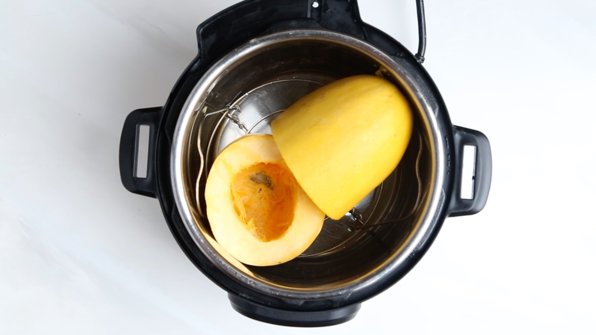 How to cook spaghetti squash in an Instant Pot. This method works well for any type of hard winter squash! | perrysplate.com