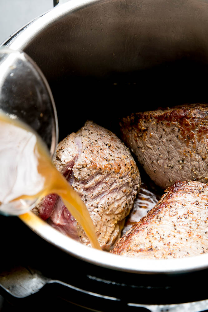Sear the pieces of roast before cooking it in your Instant Pot.