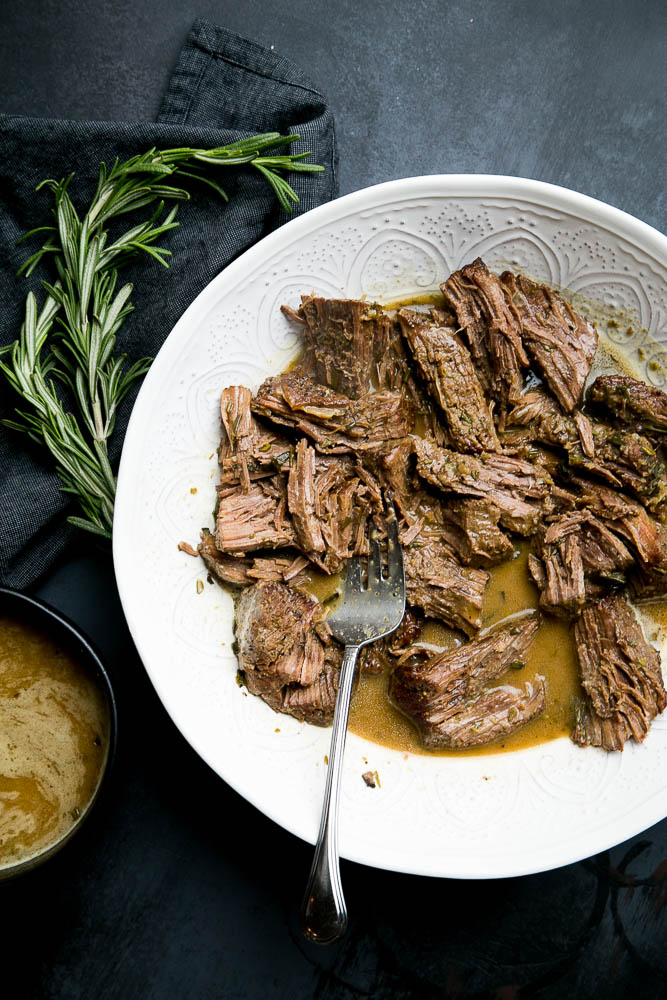 Instant Pot Pot Roast with Rosemary Gravy is an EASY weeknight meal, but special enough for company. Pair it with some mashed potatoes or roasted vegetables for a delicious meal.
