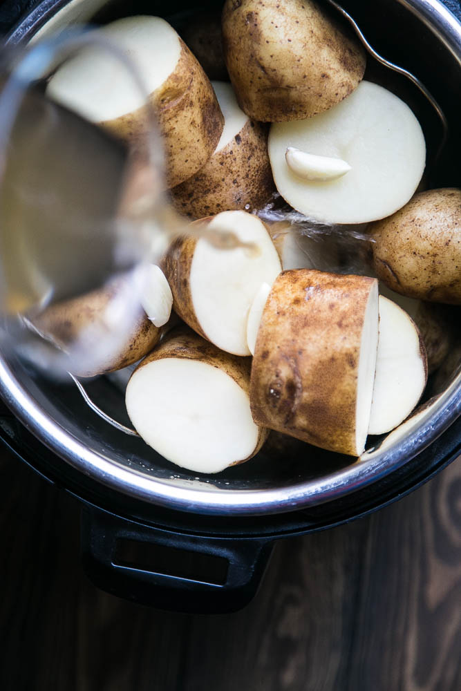 When you cook the potatoes with chicken broth, you don't have to drain the potatoes before you mash them! | perrysplate.com