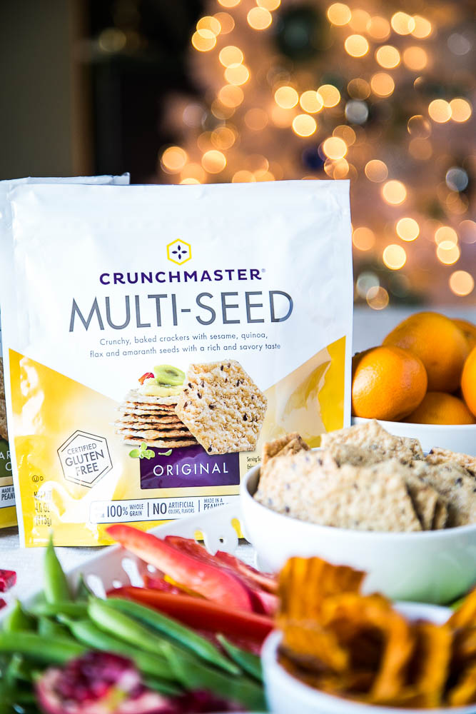 Making a kid-friendly holiday charcuterie is easy with gluten-free crackers, veggie chips and fresh veggies, fruit, and meats!