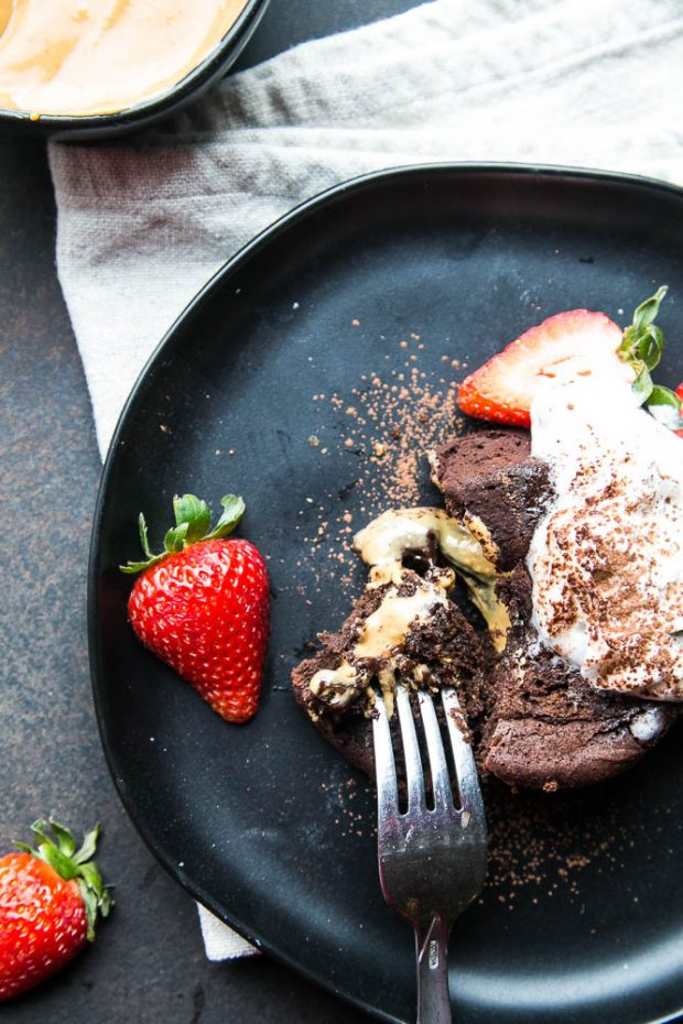 Garnish your chocolate lava cakes with whipped cream, cocoa powder, and fresh berries!
