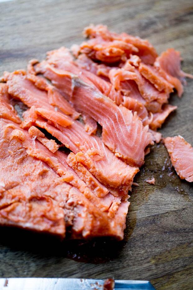 Sliced homemade gravlax with sriracha and lime. perrysplate.com