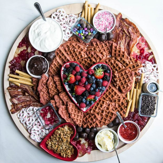 Create a fun breakfast board for Valentine's Day with your favorite waffles or pancakes!