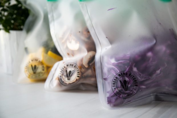 Storing chopped vegetables in reusable storage bags saves space in your refrigerator!