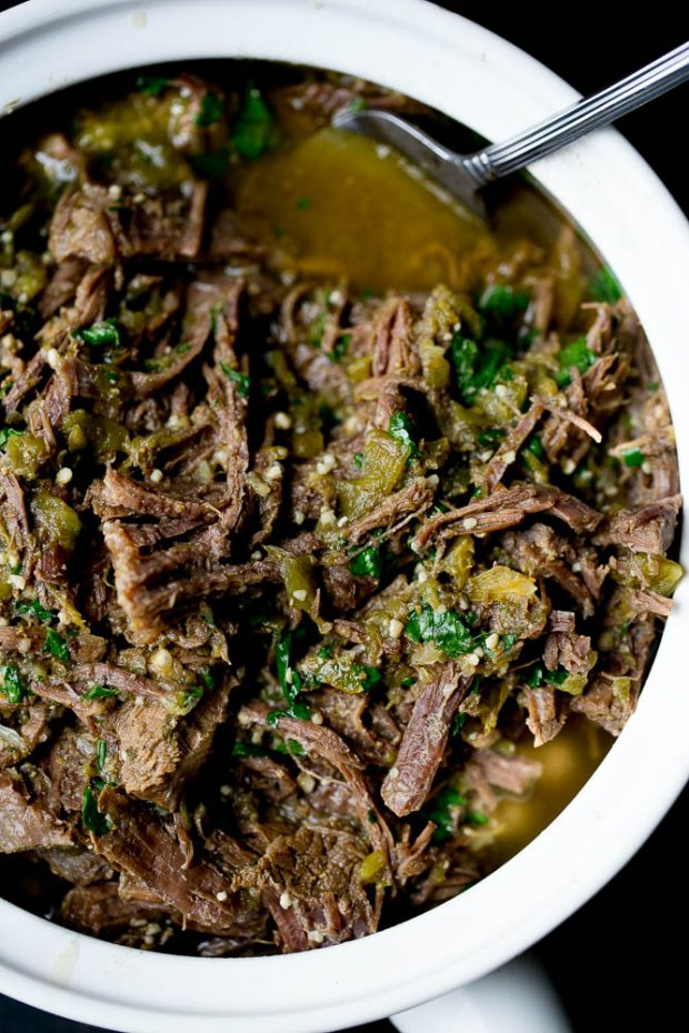 Serving dish full of shredded green chile beef ready to eat.