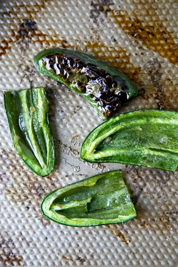 Roasting jalapenos is so easy! Just slice them in half, pull the seeds out, and roast them in a hot oven for 12 minutes.