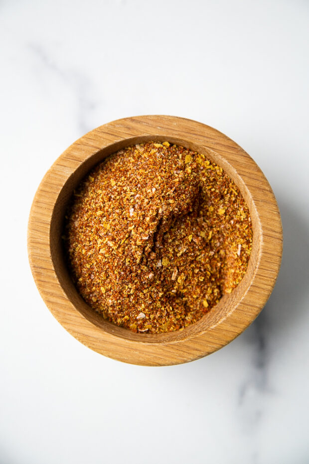 Homemade Smoky Chipotle Taco Seasoning in a small wooden bowl.