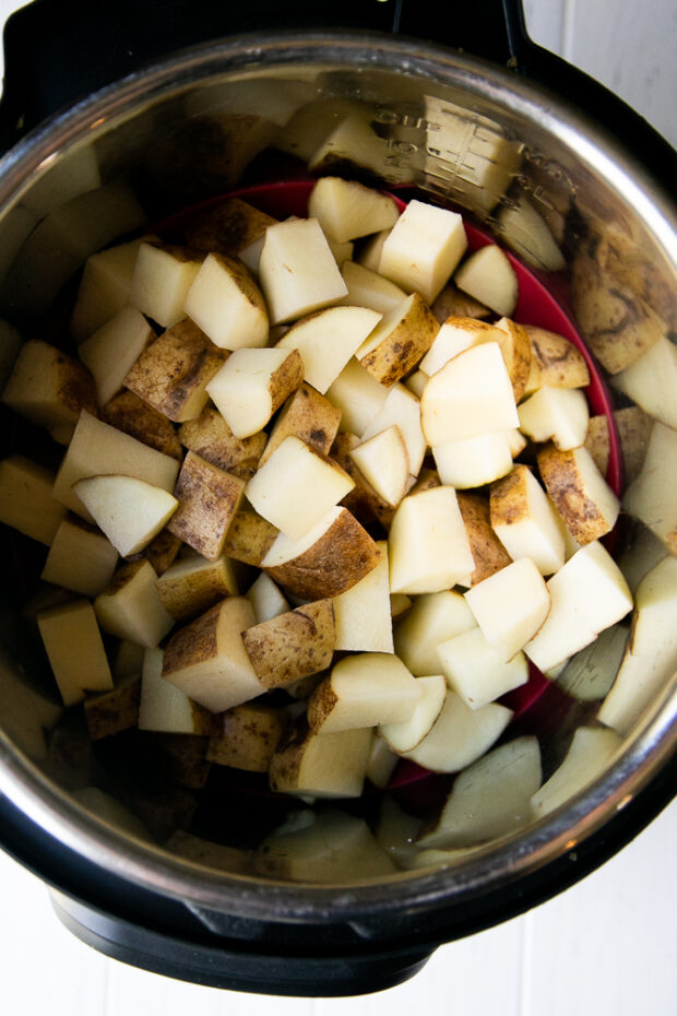 Cooking potato cubes in an Instant Pot for German Potato Salad.