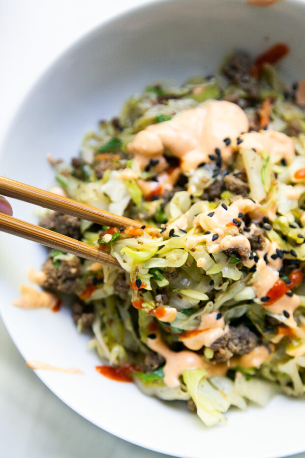 We love using chopsticks to eat Egg Roll Bowls. It's one of our famiy's favorite healthy meals and paleo-friendly.