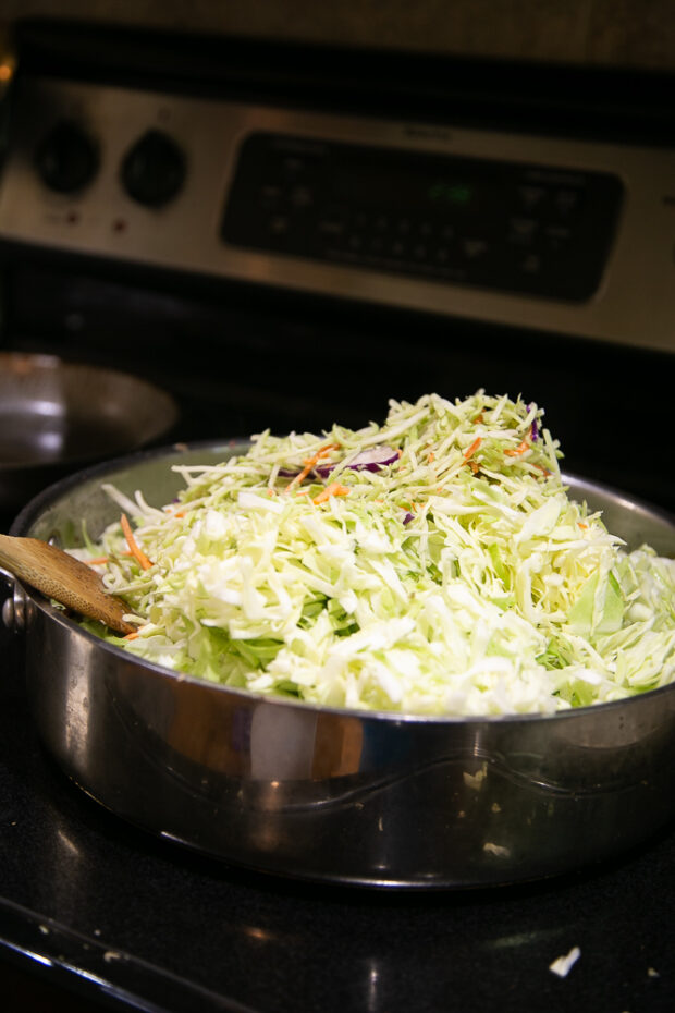 Making egg roll in a bowl using lots of shredded cabbage.