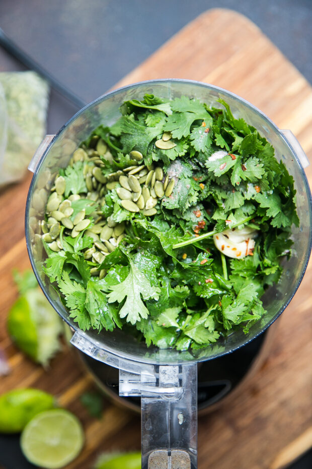 Put the cilantro in a food processor with some garlic, lime juice, and pepitas to make cilantro pesto.