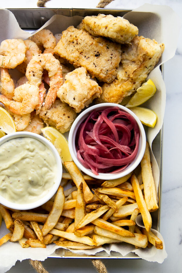 Fish Fry inspired by our trip to Aruba! Lightly breaded cod & shrimp served with garlic aioli and pickled red onions.