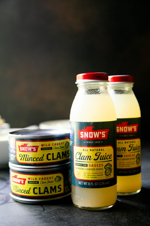 You can find clam juice and canned clams at the grocery store. I like buying minced clams, but you can use chopped clams, too.